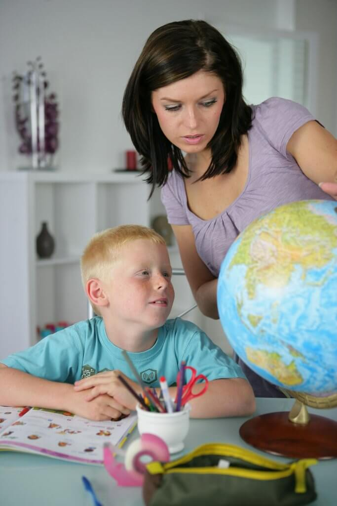 Woman giving her son a geography lesson